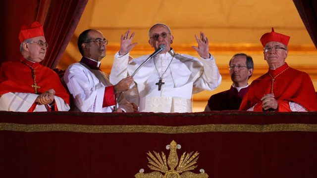 PHOTO:New Pope, Argentinian cardinal Jorge Mario Bergoglio appears at the window of St Peters Basilicas balcony after being elected the 266th pope of the Roman Catholic Church, March 13, 2013 at the Vatican.