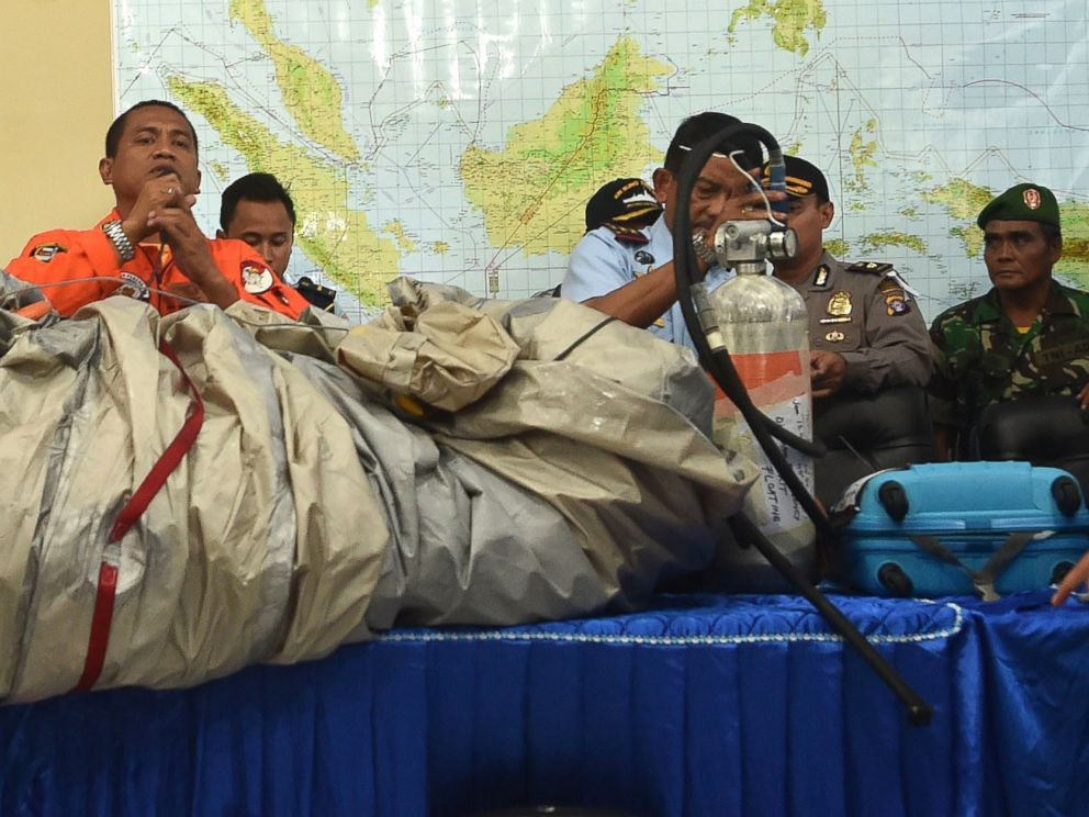 PHOTO: Members of the Indonesian air force show items retrieved from the Java sea during search and rescue operations for the missing AirAsia flight QZ8501, on Dec. 30, 2014.