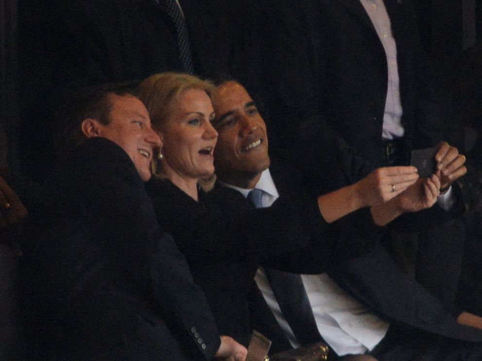 PHOTO: US President Barack Obama, right, Denmarks Prime Minister Helle Thorning Schmidt and British Prime Minister David Cameron
