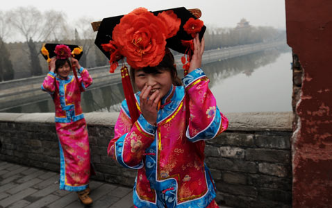 gty beijing tourists nt 120319 wblog Today in Pictures: Toulouse School Shooting, Coptic Pope Dies, and Cherry Blossoms