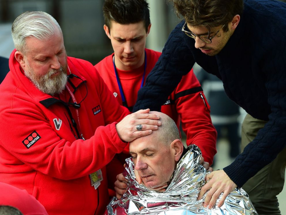 PHOTO: A victim receives first aid on March 22, 2016 near Maalbeek metro station in Brussels, after a blast at this station near the EU institutions caused deaths and injuries.