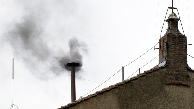 PHOTO: Black smoke rises from the chimney on the roof of the Sistine Chapel meaning that cardinals failed to elect a new pope in the second ballot of their secret conclave, March 13, 2013 at the Vatican.