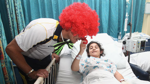 gty cricketers visit hospital thg 120215 wblog Today in Pictures: Piglets, Sri Lanka, Clowns, Jeremy Lin and the Queen