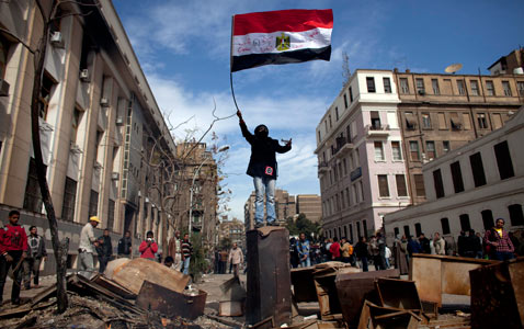 gty egypt flag nt 120203 wblog Pictures of the Day: Egypt Protests, Soul Train, Lantern Festival