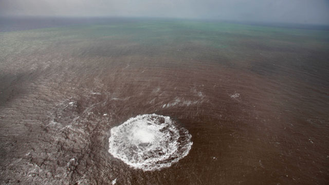 PHOTO: Aerial view taken, Oct. 17, 2011 of a green and brown stain at sea off the coast of the village of La Restinga on the Spanish Canary Island of El Hierro.