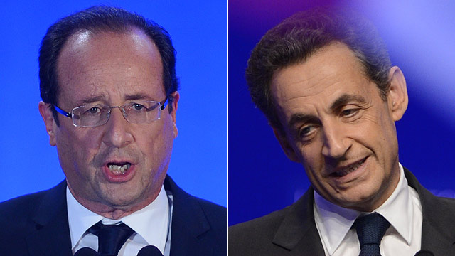 PHOTO: Socialist Party (PS) newly elected president Francois Hollande gives a speech after the results of the second round of the presidential election on May 6, 2012 in Tulle, southwestern France, and Right-wing incumbent candidate Nicolas Sarkozy (R) ad