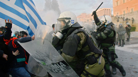 gty greece riots ss thg 120213 wblog Today in Pictures: Snow Monkeys, Athens Clashes, Westminster Dogs, and The Grammys