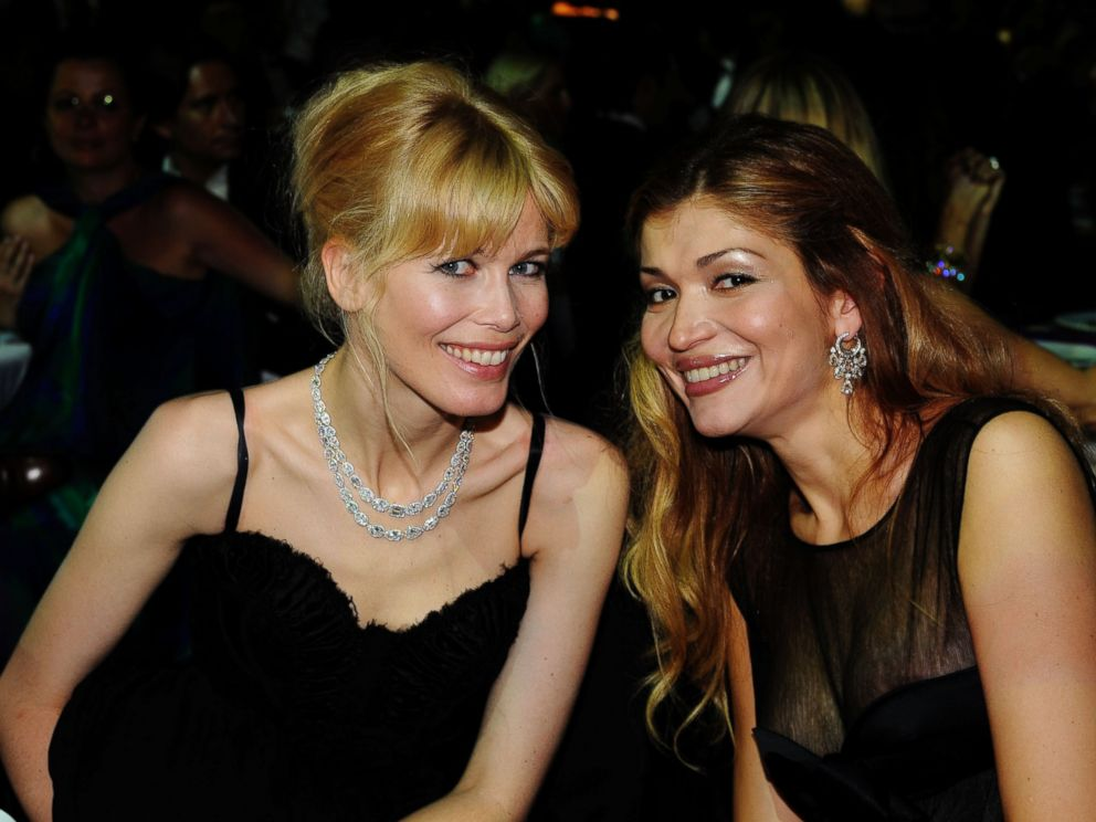 PHOTO: Claudia Schiffer and Gulnora Karimova attend the amfAR Cinema Against AIDS 2009 dinner at the Hotel du Cap during the 62nd Annual Cannes Film Festival on May 21, 2009 in Antibes, France.