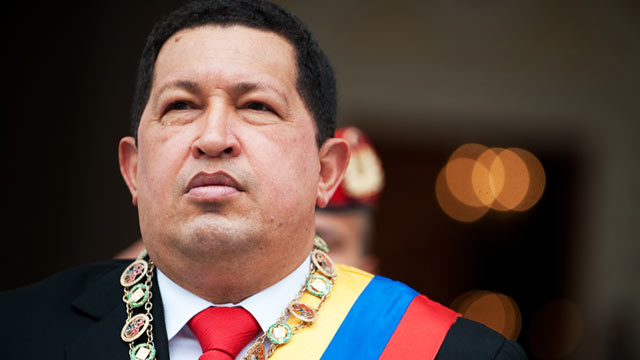 PHOTO: Venezuelan President Hugo Chavez, listens to the national anthem as he arrives at the Congress building in Caracas, Jan. 15, 2011 to present the 2010 annual report to the National Assembly.