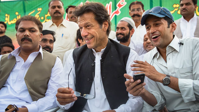 PHOTO: Imran Khan, center, smiles as he addresses supporters during an election campaign rally, May 1, 2013, in Narowal, Pakistan.