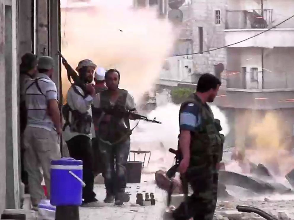 PHOTO: An image grab taken from AFP TV shows Syrian rebels taking position during clashes with Syrian regime forces in the Amariyeh district of the northern city of Aleppo in this Aug. 31, 2012 file photo.