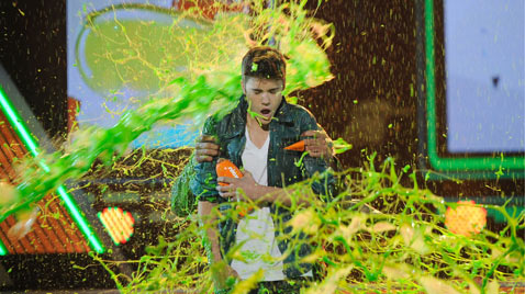 gty justin bieber slimed ss thg 120402 wblog Today in Pictures: Hindu Goddess festival, Damien Hirst, MyanMar Cheer, Bieber Slimed and The Pope