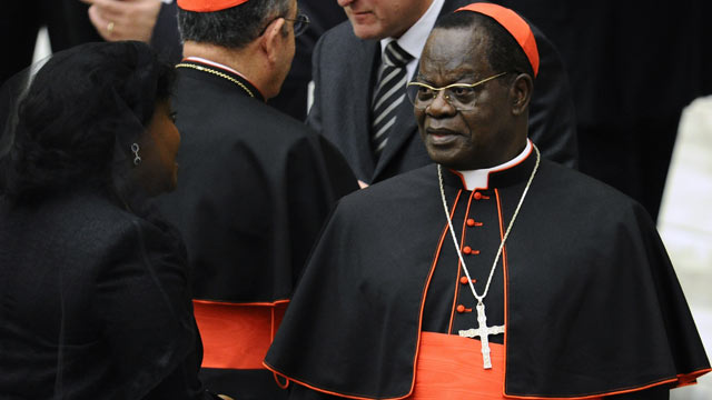 PHOTO: Laurent Monsengwo Pasinya speaks with a relative, November 2010, at the Paul VI hall at The Vatican.