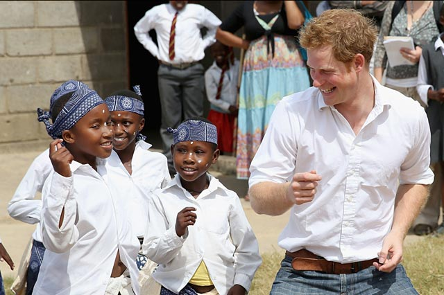 gty lesotho prince harry ll 130227 wblog Today in Pictures: Prince Harry, Pope Posters, Tearful Testimony