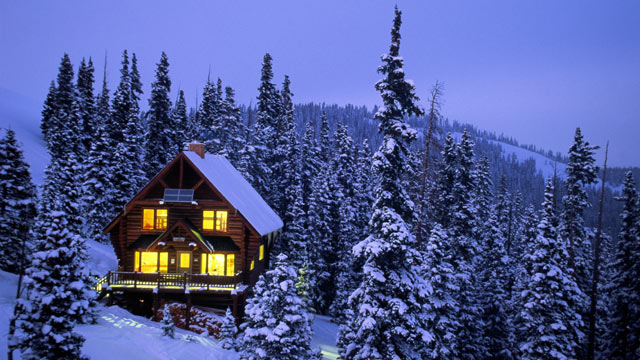 PHOTO: A snow-covered ski cabin in the mountains is shown.