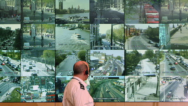 PHOTO: A police officer watches banks of television monitors showing a fraction of Londons CCTV camera network.