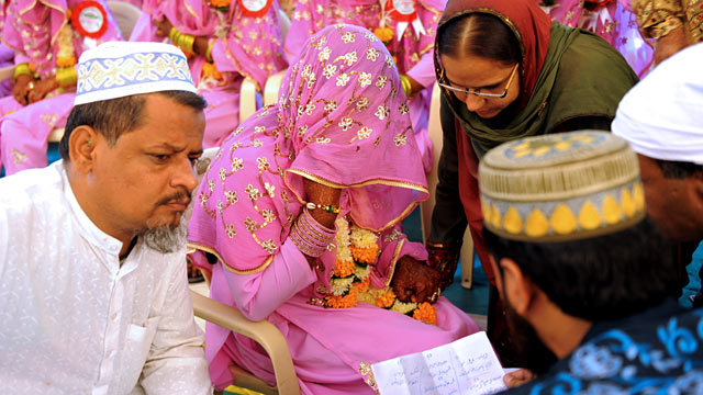 """PHOTO: An Indian Muslim bride, center, answers questions by religious leaders during the """"Nikah Kabool Hai"""" or """"Do You Agree for the Marriage."""""""