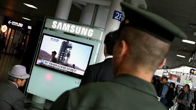 PHOTO: A South Korean marine watches a television report on North Koreas rocket launch at Seoul Station in Seoul, South Korea, April 13, 2012.