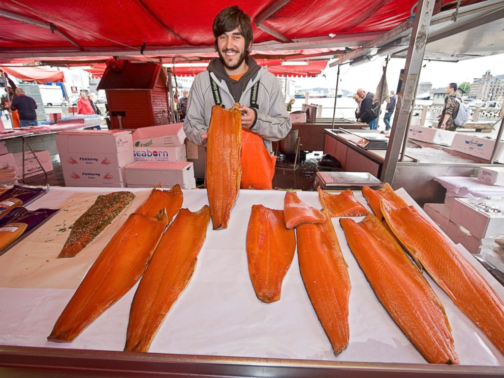 PHOTO: A man offers salmon for sale at the waterfront fish market in Bergen, Norway.
