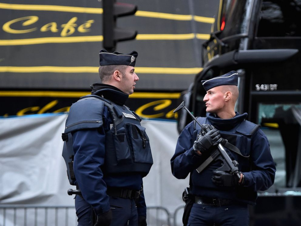 PHOTO: French police officers stand guard in front of the main entrance of Bataclan concert hall as the cordon is lifted following Fridays terrorist attacks on Nov. 16, 2015 in Paris.