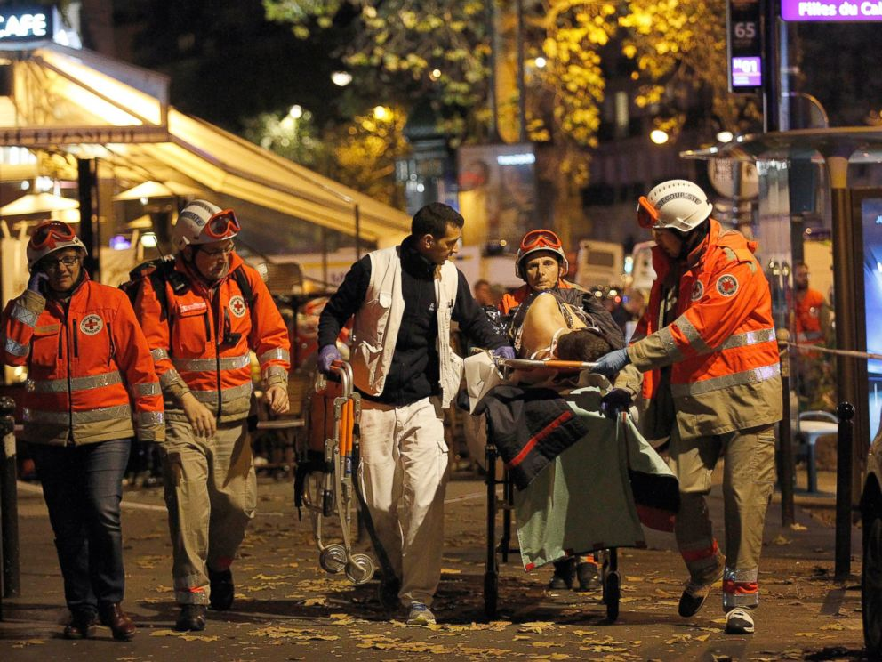 PHOTO: Medics evacuate an injured person on Boulevard des Filles du Calvaire, close to the Bataclan theater, early on Nov. 14, 2015 in Paris.