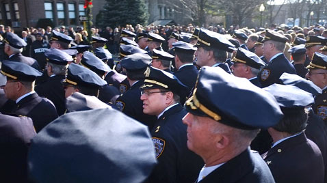 gty police funeral thg 111219 wblog Today In Pictures: Dec. 19, 2011