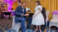 Prince Harry Goofs Around With a Little Girl