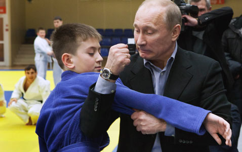 gty putin arm wrestle nt 120125 wblog Today in Pictures: Northern Lights, Monte Carlo International Circus, and the Egyptian Revolution