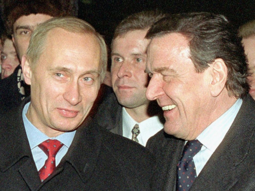 PHOTO: German Chancellor Gerhard Schroeder (R) and Russian President Vladimir Putin (L) walk in Red Square Jan. 6, 2001.