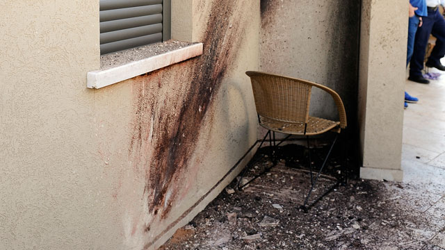 PHOTO: A picture shows the damage outside a house after a rocket launched from the Gaza Strip hit the southern city of Sderot on March 21, 2013.