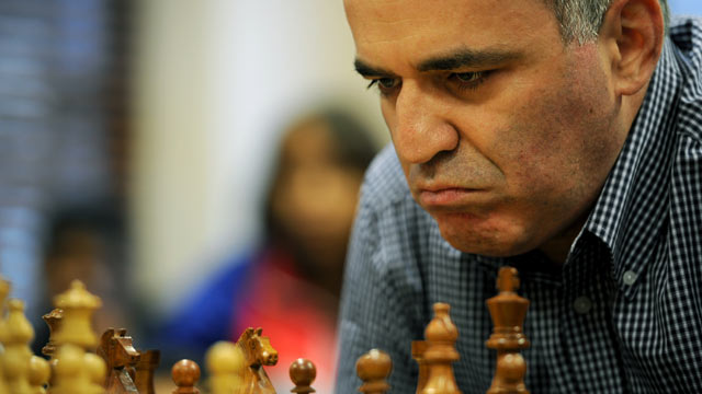 PHOTO: Former World Chess Champion Garry Kasparov plays a game of chess against South African champion Marcil Roberts, March 22, 2012 in Cape Town, South Africa.