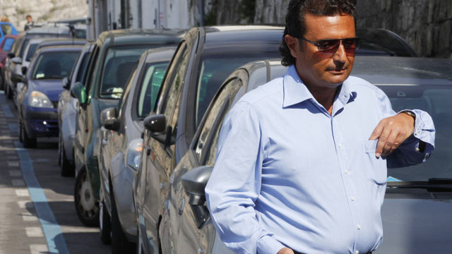 PHOTO: Costa Concordia cruise former captain Francesco Schettino walks to his car in Meta di Sorrento on October 14, 2012 in this file photo.