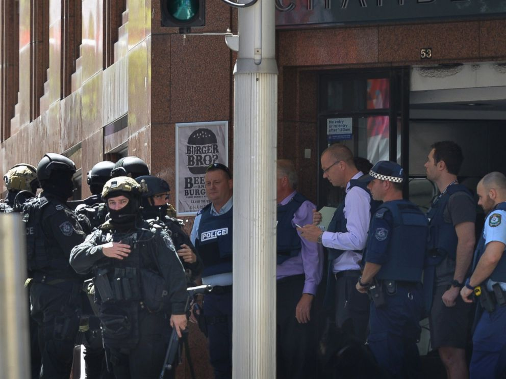 PHOTO: Armed police are seen outside a cafe in the central business district of Sydney on Dec. 15, 2014.