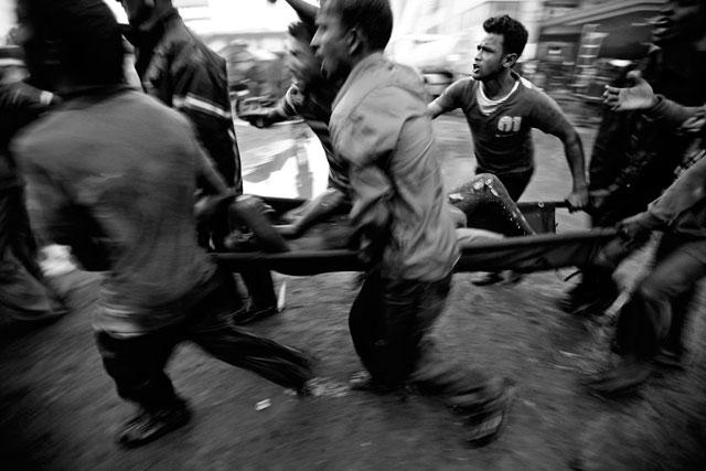 ht abir bangladesh garment traps 2  stretcher thg 130501 wblog The Deadly Cost of Cheap Clothing: Dangers in Bangladesh