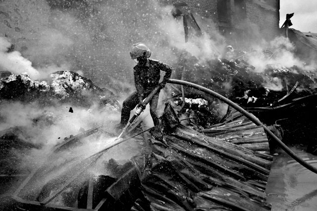 ht abir bangladesh garment traps fire fighter thg 130501 wblog The Deadly Cost of Cheap Clothing: Dangers in Bangladesh