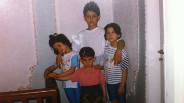 PHOTO: Sitting at her kitchen table, aunt Patemat Sulemanova cried softly as she showed ABC News photos of the two bombing suspects -- Tamerlan Tsarnaev and and Dhzokhar Tsarnaev when they were young boys. as they posed with their two sisters.
