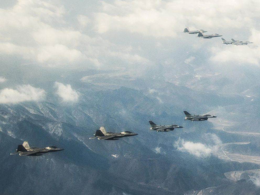 PHOTO: Four U.S. Air Force F-22 Raptor fighter aircraft from Kadena Air Base, Japan, fly over the skies of South Korea. The Raptors were joined by four F-15 Slam Eagles and U.S. Air Force F-16 Fighting Falcons.