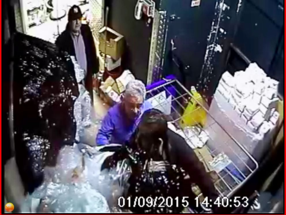 PHOTO: People being held hostage by Amdedy Coulibaly in a supermarket in Paris, France appear to disable or alter a security camera in this security footage, Jan. 9, 2015.