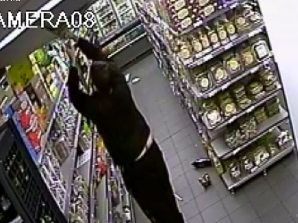 """PHOTO: """"People being held hostage by Amdedy Coulibaly in a supermarket in Paris, France appear to disable or alter a security camera in this security footage, Jan. 9, 2015."""""""