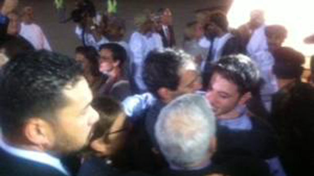 PHOTO:The US hikers freed from jail in Iran land in Oman and are greeted by their families, Sept. 21, 2011.