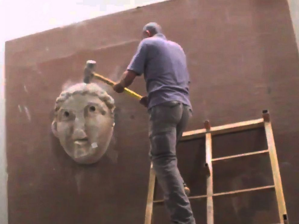 PHOTO: In a video released by the terror group ISIS in February 2015, militants purportedly destroy artifacts in a museum in Mosul, Iraq.