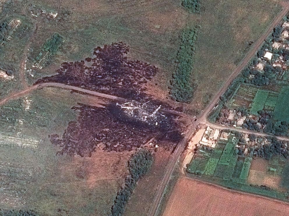 PHOTO: The primary crash site and debris field is seen in the middle of burned vegetation in a satellite image showing the crash site of Malaysia Airlines Flight 17 which was shot down in east Ukraine, on July 17, 2014.