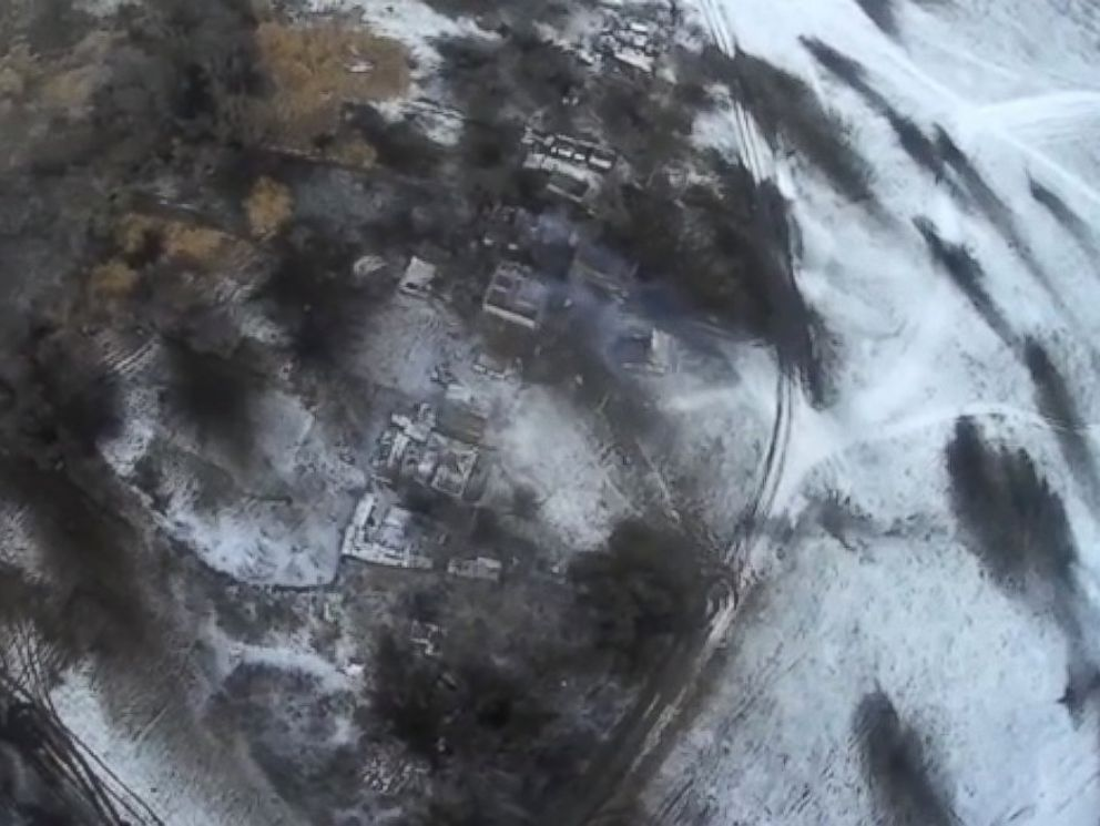 PHOTO: A drone video posted to YouTube on Feb. 18, 2015 shows the aftermath of shelling in Debaltseve, Ukraine, Feb. 18, 2015. The black scorch marks are impact craters.