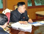 PHOTO: North Korean leader Kim Jong-Un presides over a national defense meeting with his top officials, Jan. 27, 2013.