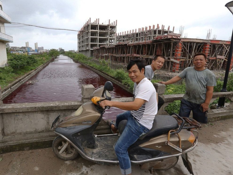 PHOTO: The river in Xinmeizhou village in eastern Chinas Zhejiang province quickly filled up with the red colored liquid which had a strange smell, according to villagers, July 25, 2014.