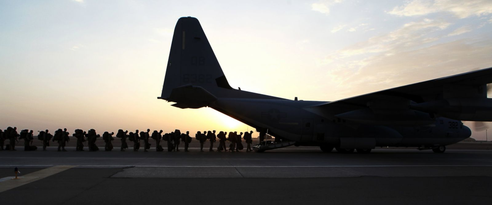 PHOTO: Marines and sailors with Marine Expeditionary Brigade in Afghanistan load onto a KC-130 aircraft at Camp Bastion, Helmand Province, Afghanistan, Oct. 27, 2014.