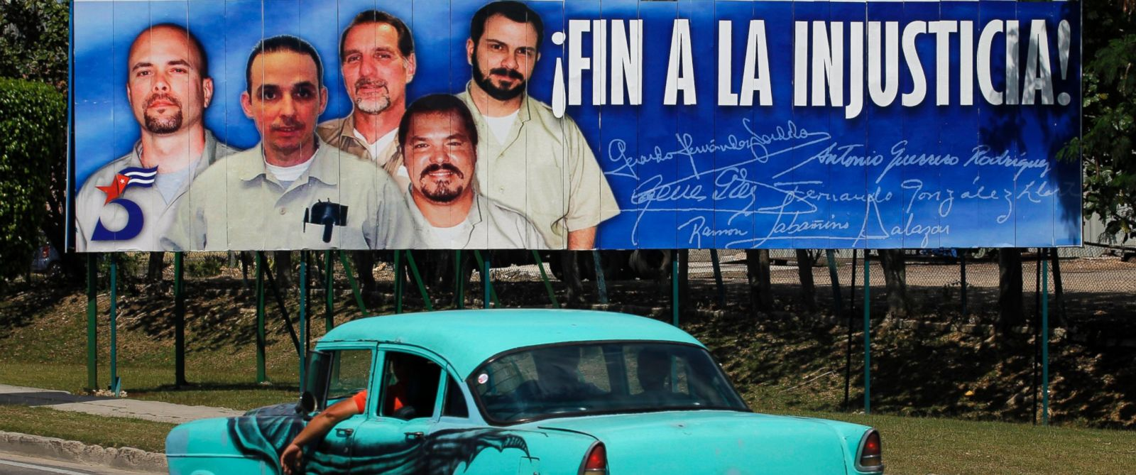 PHOTO: A car drives past a poster of the five Cuban prisoners in U.S. jails, in Havana March 30, 2012.