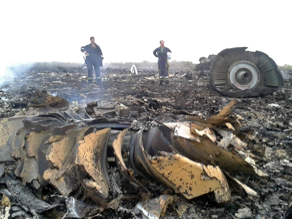 PHOTO: Emergencies Ministry members work at the site of a Malaysia Airlines Boeing 777 plane crash in the settlement of Grabovo in the Donetsk region, July 17, 2014.