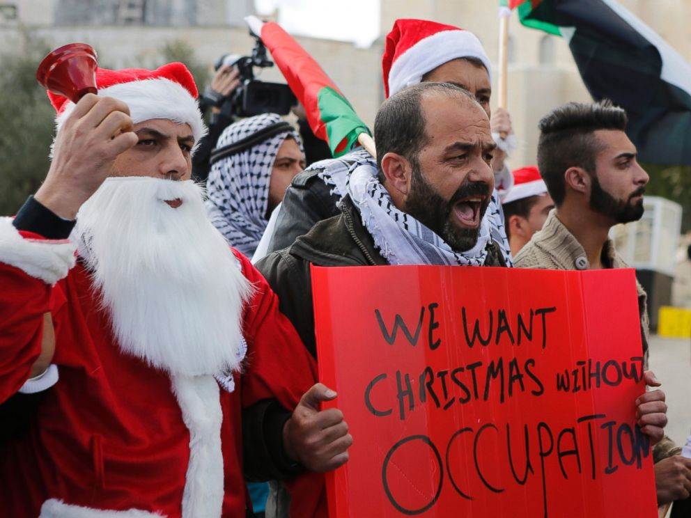 PHOTO: A Palestinian protestors demonstrate against Israeli settlements during Christmas, near a checkpoint in the West Bank city of Bethlehem, Dec. 23, 2014.