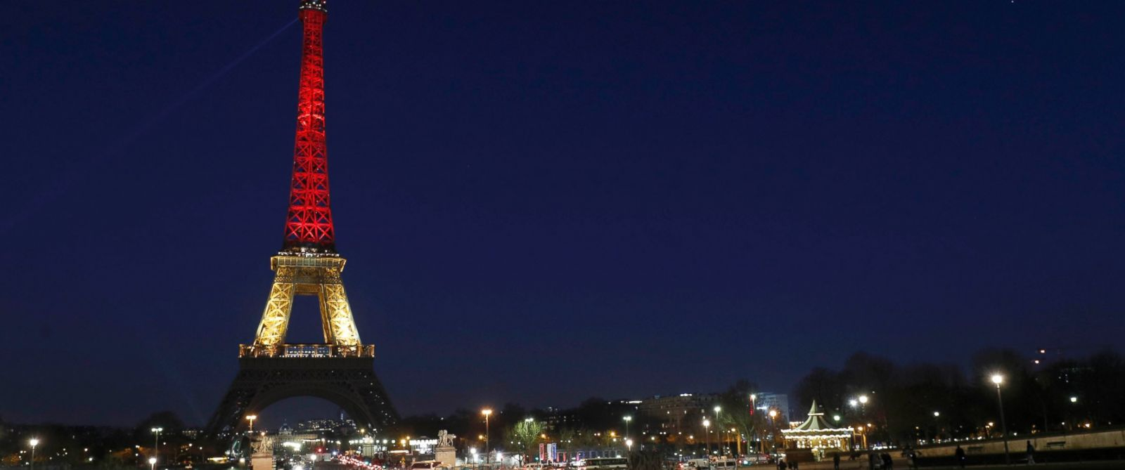 PHOTO: The Eiffel Tower is seen with the colors of the Belgian flag in tribute to the victims of todays Brussels bomb attacks, in Paris, France, March 22, 2016.